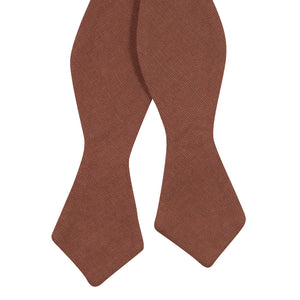 Sedona Self Tie Bow Tie. Solid light faded red textured fabric.