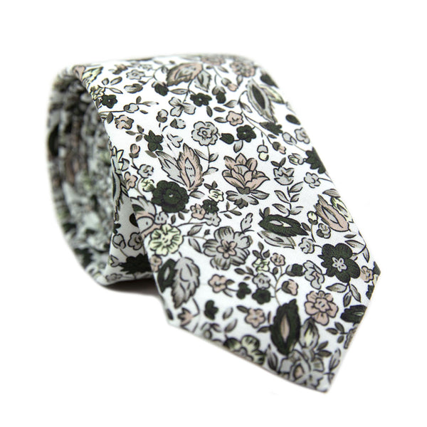 Silhouette Skinny Tie. White background with gray, black and light tan flowers and leaves.