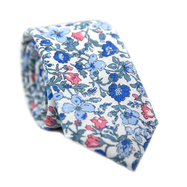 Spring Bloom Skinny Tie. White background with blue and pink flowers and light turquoise vines and leaves.