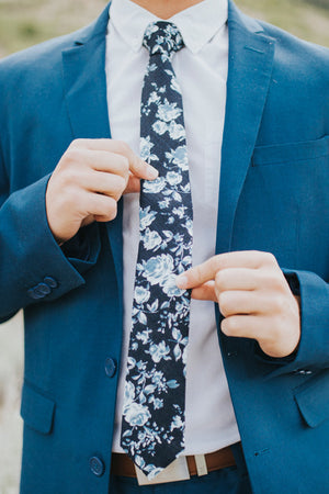 Star Gaze tie worn with a white shirt, brown belt and royal blue suit.
