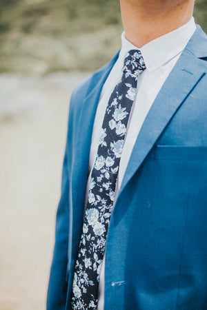 Star Gaze tie worn with a white shirt and royal blue suit jacket.