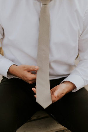 Stone tie worn with a white shirt and black pants.