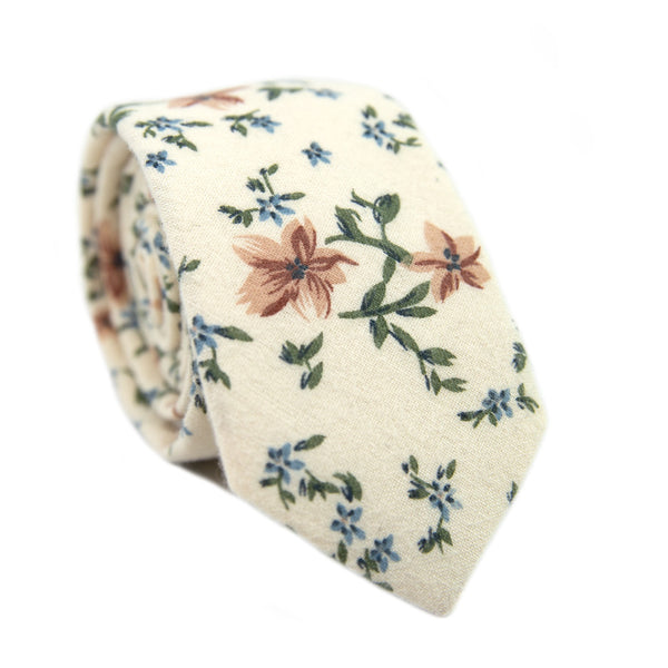 Sugar Blossom Skinny Tie. Cream background with medium size mauve flowers, small dusty blue flowers, and sage green leaves.