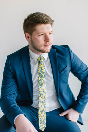 Sunburst tie worn with a textured white shirt and royal blue suit.