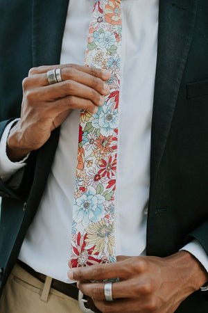 Sundance tie worn with a white shirt, navy suit jacket and khaki pants.