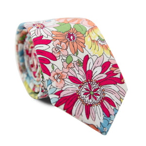 Sundance Skinny Tie. White background with various sizes of orange, pink, yellow and dusty blue flowers.