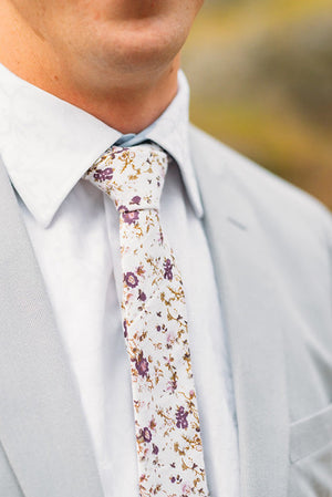 Sweetly Picked tie worn with a white shirt and light gray suit jacket.