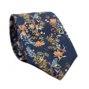 Tiger Lily Skinny Tie. Dark navy blue background with peach flowers and dusty blue, yellow, green and black leaves.