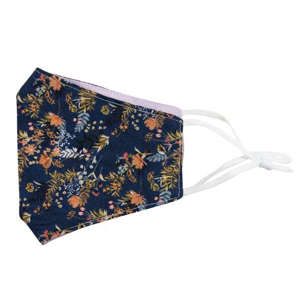 Tiger Lily and Lavender Reversible Face Mask. Outside is dark navy blue background with peach flowers and dusty blue, yellow, green and black leaves. Inside is solid light purple textured fabric. White adjustable straps to loop over ears.