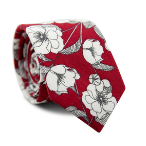 Torch Skinny Tie. Red background with medium sized white and black flowers and leaves.