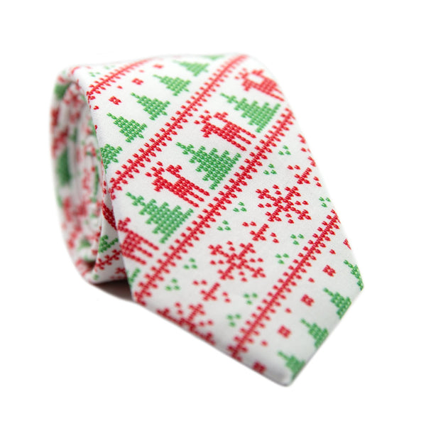 Ugly Sweater Skinny Tie. Christmas themed tie with white background and lines of green pine trees, red reindeer, red snow flakes, and red and green dots.