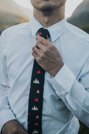 Utah tie worn with a white shirt.