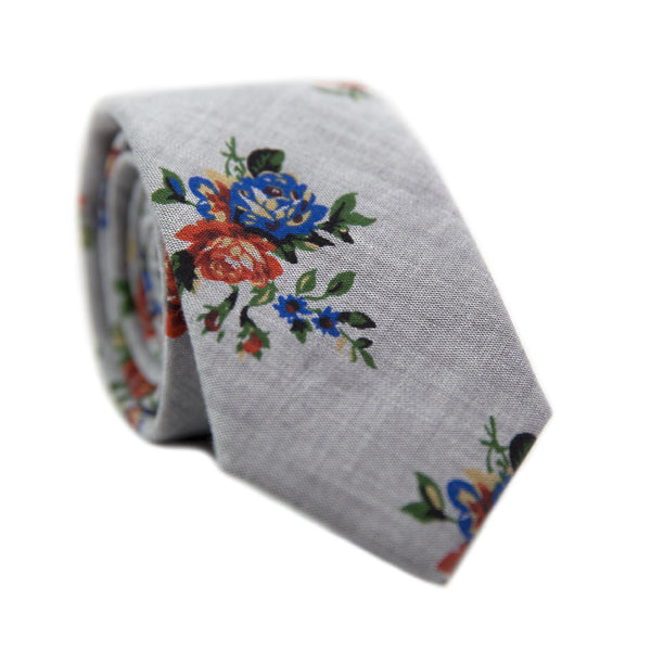 Vintage Flor Skinny Tie. Gray textured background with burnt orange and royal blue flowers, sage green leafy vines.