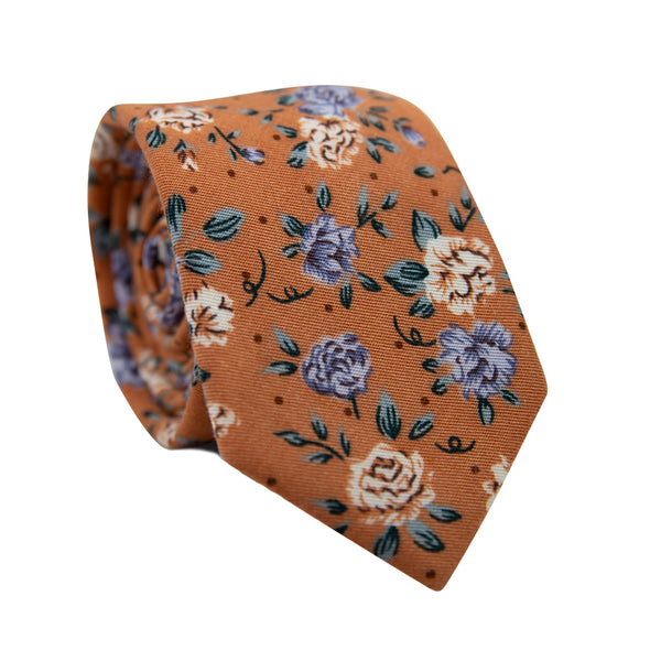 Western Skinny Tie. Orange background with blue and white flowers and small green leaves throughout.