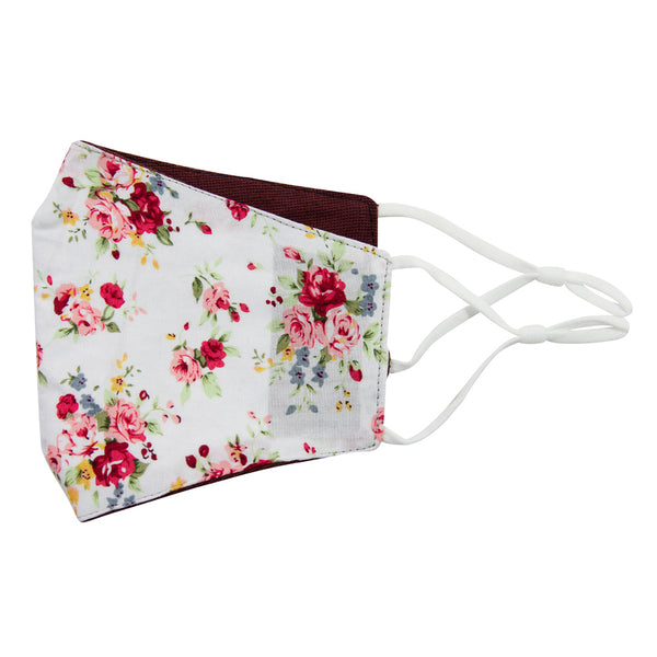White Floral and Merlot Reversible Face Mask. Outside is white background with red, pink, blue and gold flowers and green leaves and stems. Inside is solid burgundy textured fabric. White adjustable straps to loop over ears.