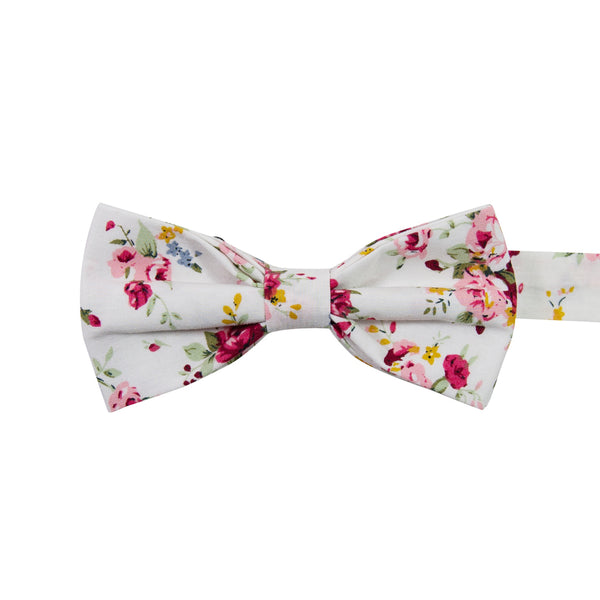 White Floral Pre-Tied Bow Tie. White background with red, pink, blue and gold flowers. Green leaves and stems.