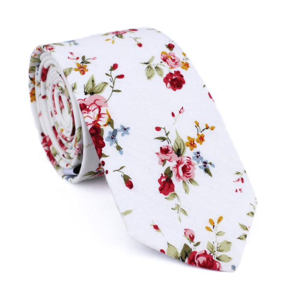 White Floral Skinny Tie. White background with red, pink, blue and gold flowers. Green leaves and stems.