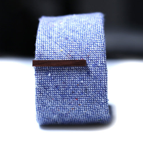 Dark Brown Wood Tie Bar on a textured blue tie.