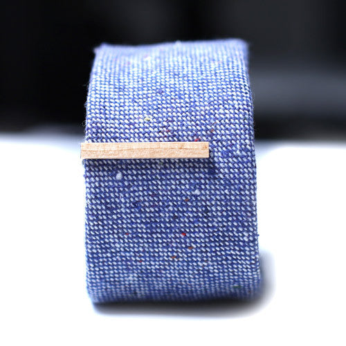 Light Brown Wood Tie Bar on a textured blue tie.