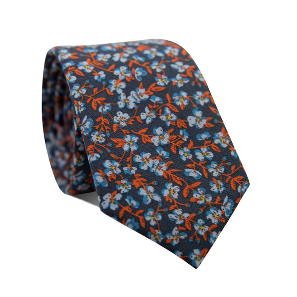 Lonely Nights Skinny Tie. Navy blue background with small dusty blue flowers and rust orange leafy vines throughout.