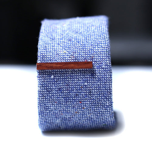 Red Brown Wood Tie Bar on a textured blue tie.