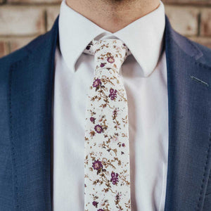 Sweetly Picked tie worn with a white shirt and navy suit jacket.