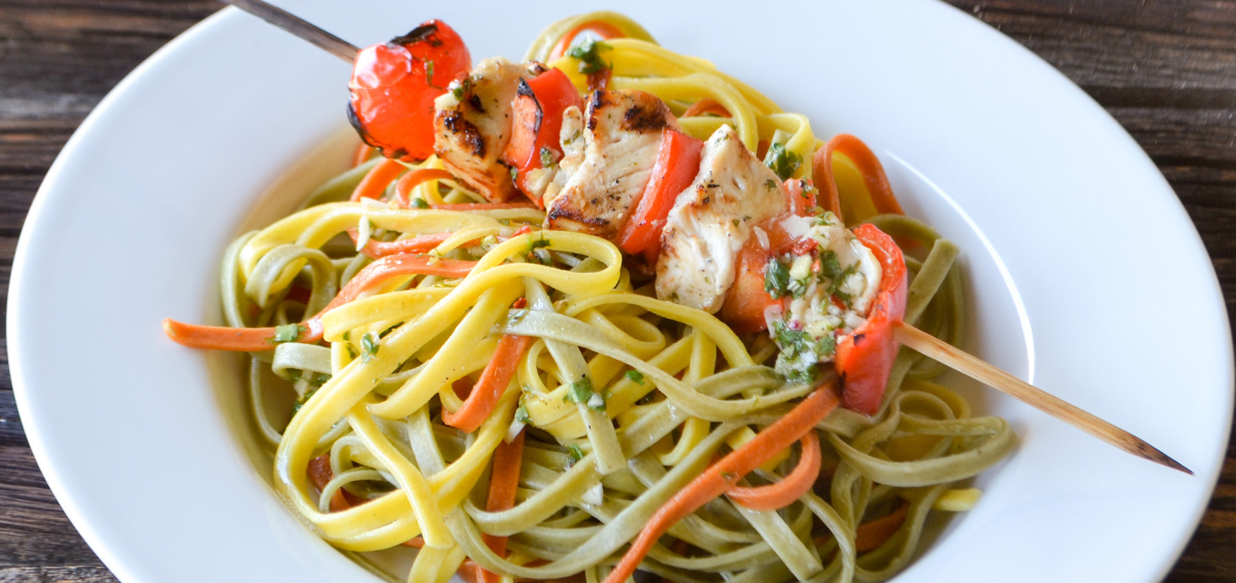 Cilantro Lime Chicken Skewers over Bell Pepper Trio Linguine