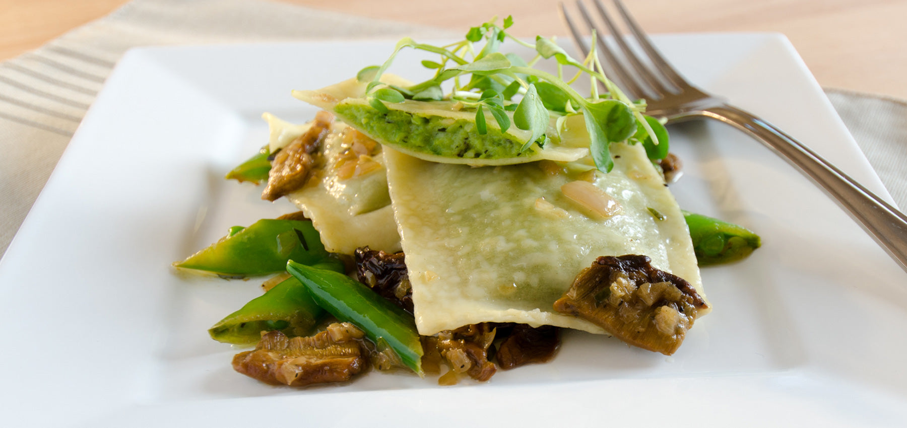 Garden Mint Pea Ravioli with Porcini Mushrooms & White Wine