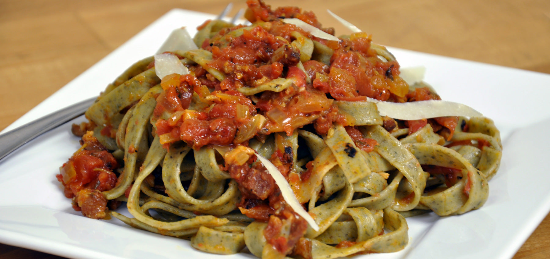 Roasted Garlic Herb Fettuccine tossed with Spiced Muir Glen Fire Roasted Tomatoes & Applewood Smoked Bacon Sauce