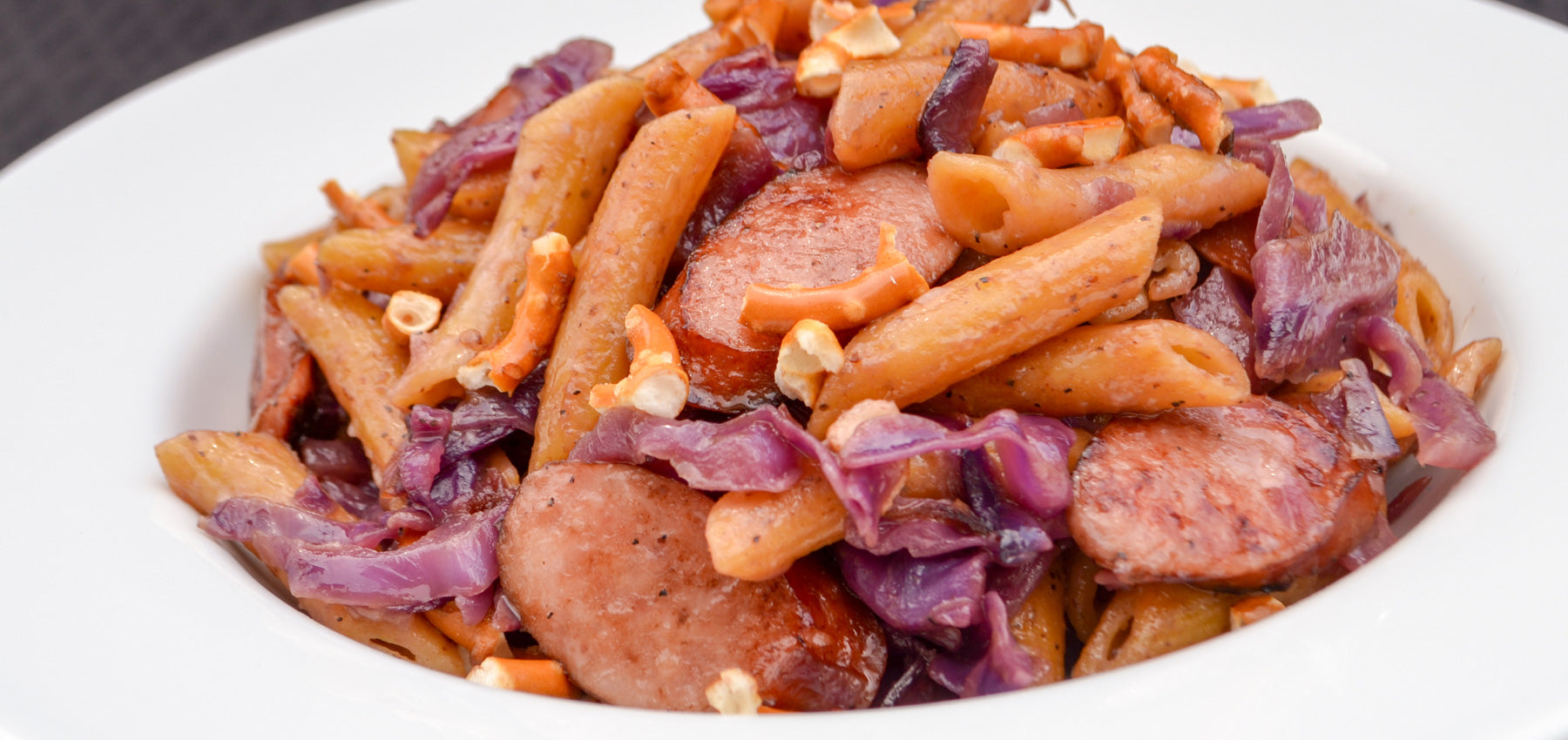 Stone Ground Coarse Mustard Penne with Beer-Braised Cabbage & Brats