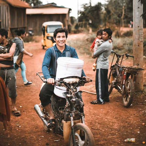 Cambodia man taking home water filter