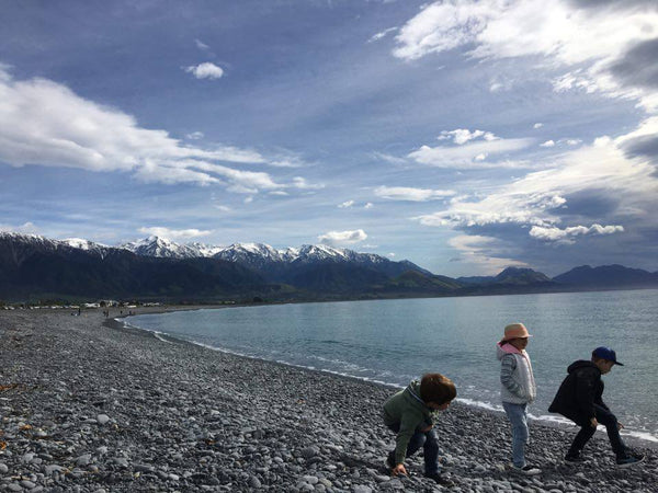Three children on a New Zealand beach