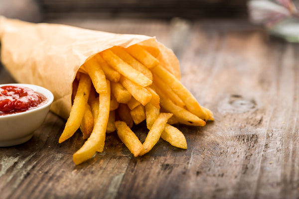 Chips (french fries) lying on a wooden board