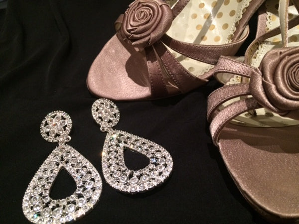 Image of sparkly earings and evening shoes