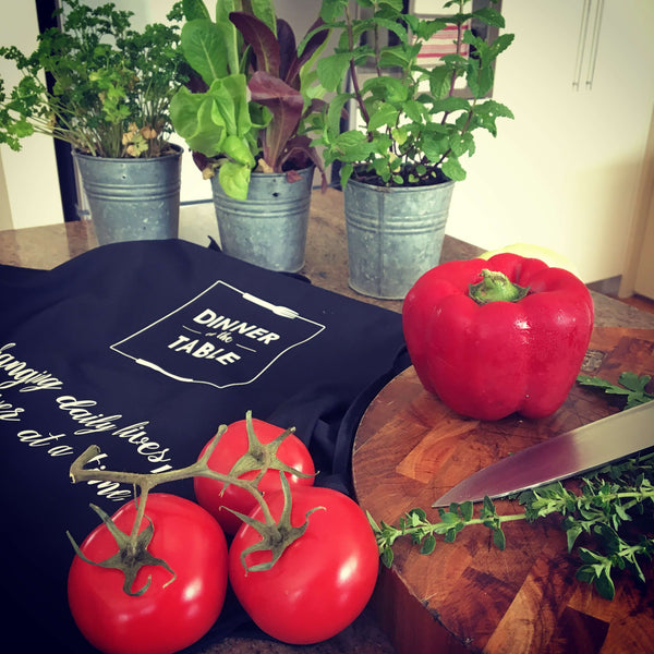Tomatoes, herbs and apron