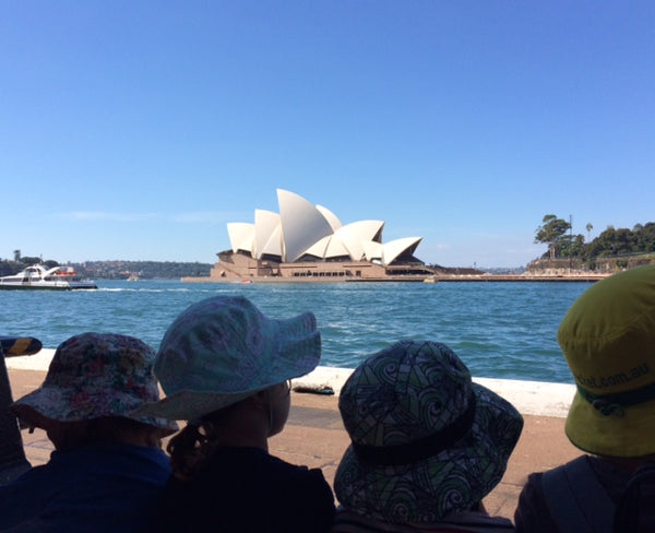 Four children looking at the Sydney Opera House