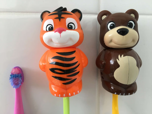 Image of two children's toothbrush holders and a single toothbrush with no holder