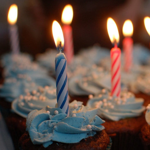 Cupcakes with birthday candles, one in each