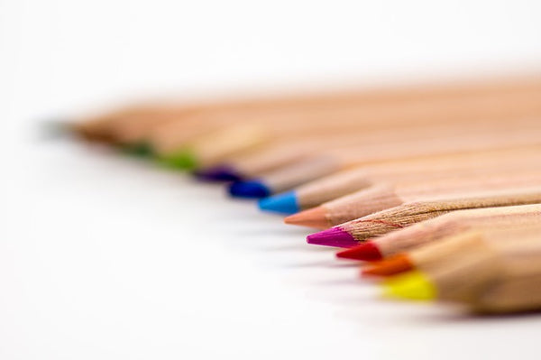 Coloured pencils in a line