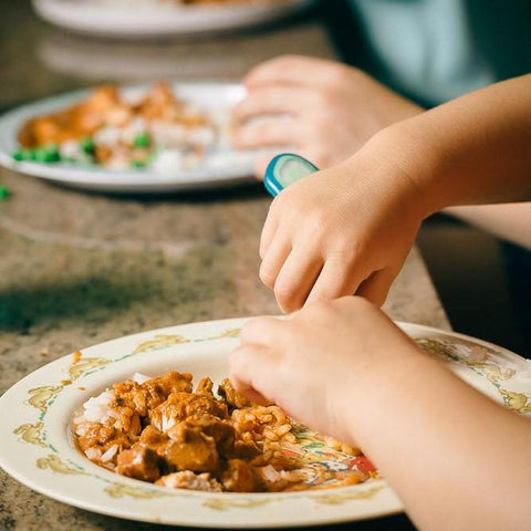 ready made home delivery meals featuring a child eating curry