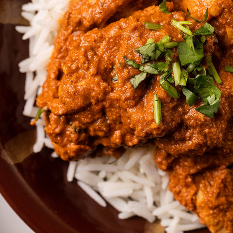 ready made home delivery meals featuring butter chicken on rice