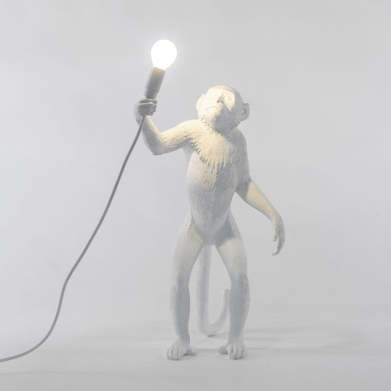 white monkey lamp standing