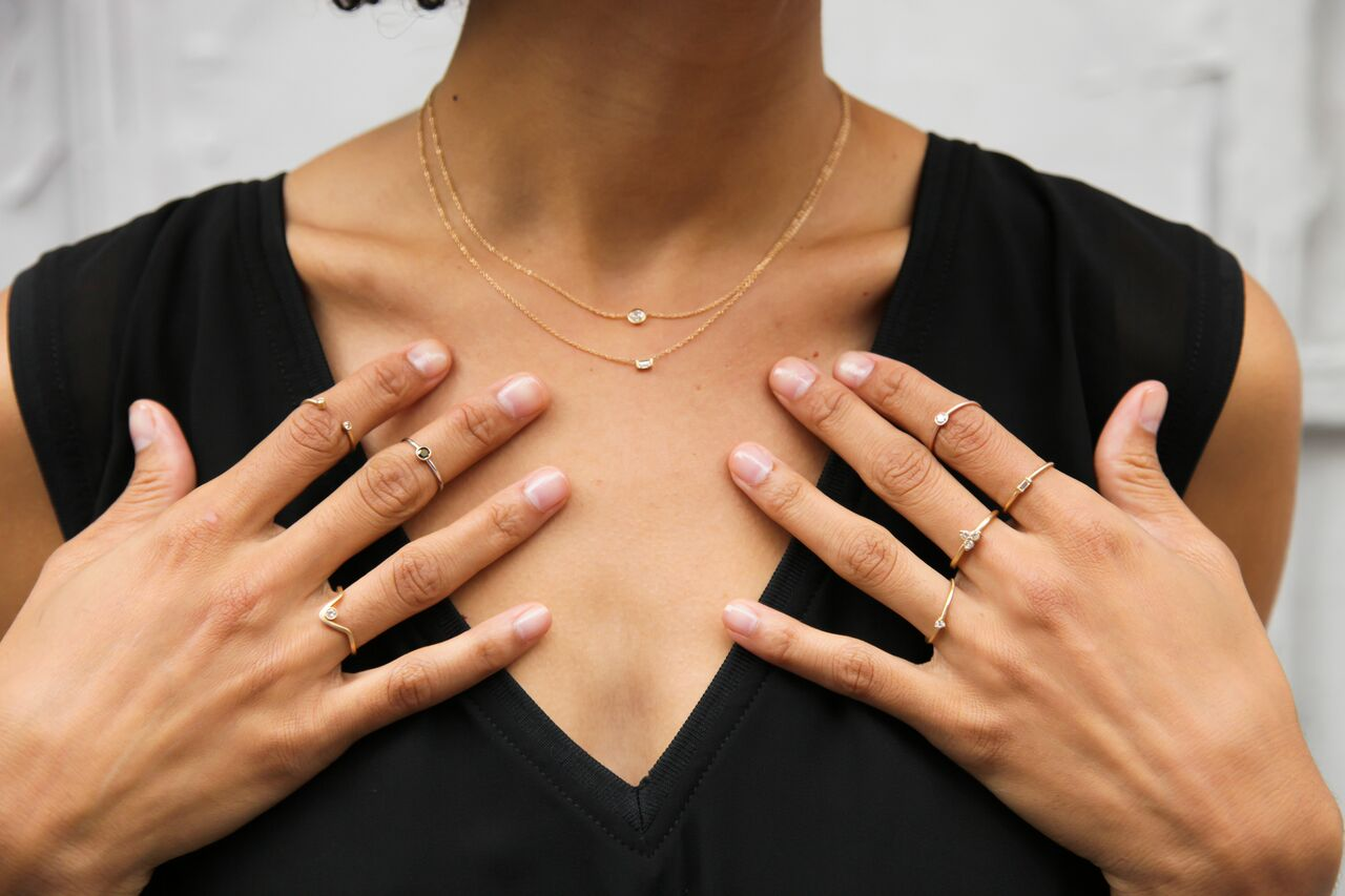 Girl wearing diamond rings and diamond necklaces