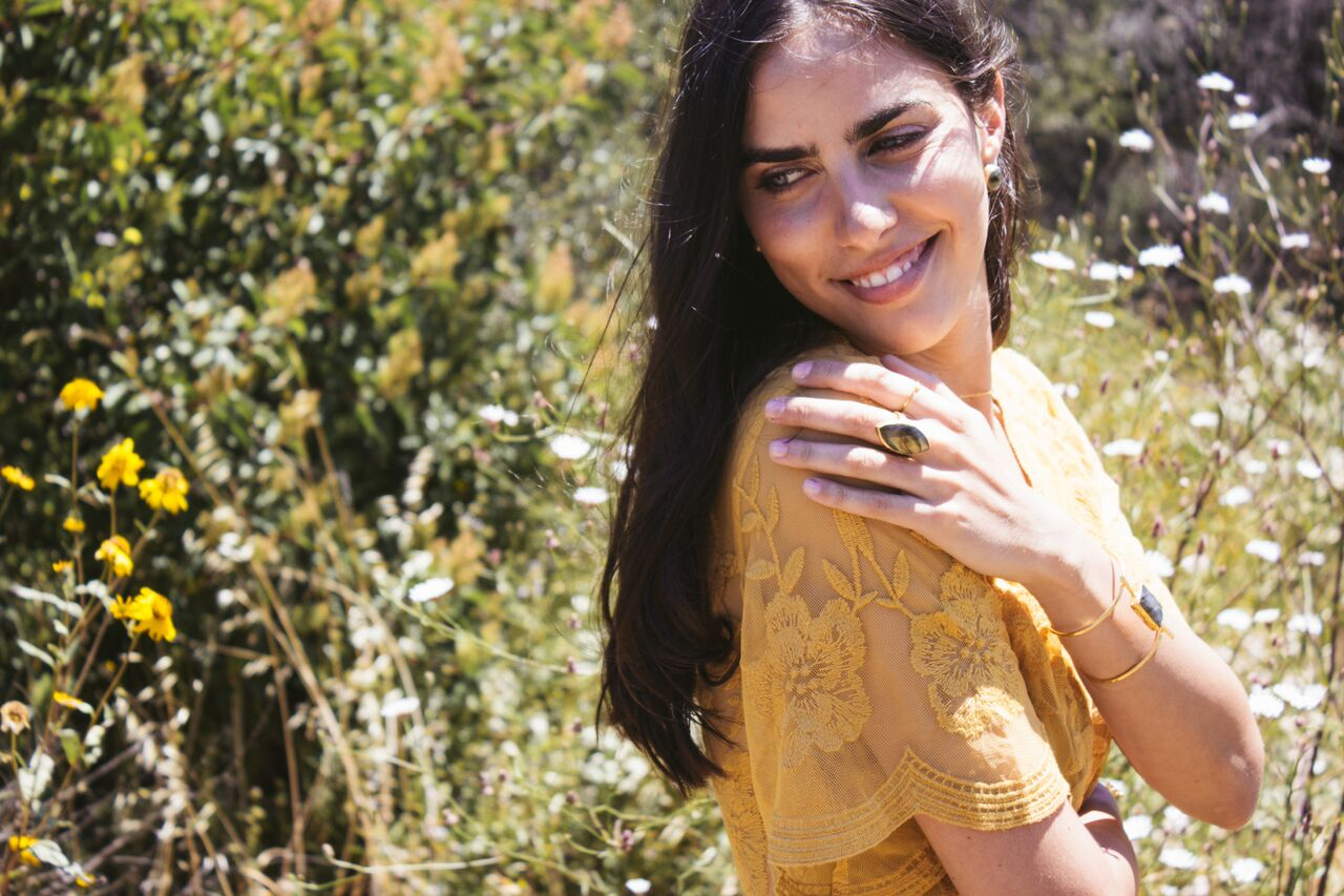 Girl In Wildflower Fields Wearing A Mustard Dress & Jewelry