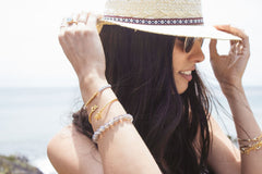 Detail Shot Of Girl Wearing Hat Showing Off Bracelets & Rings