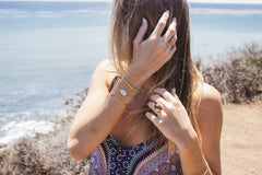 Detail Shot of Girl Wearing Bracelets On The Beach