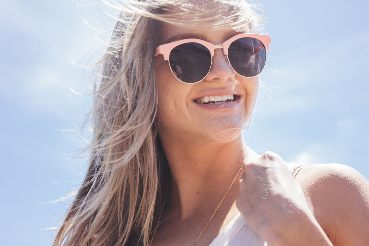 Girl Wearing Pink Sunglasses