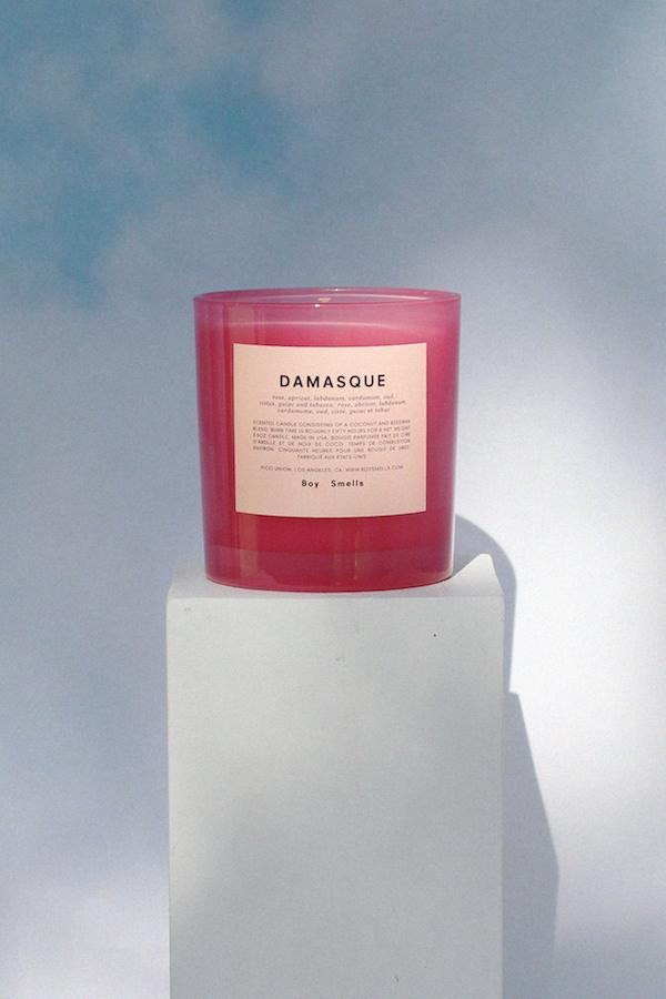 Damasque Boy Smells Candle