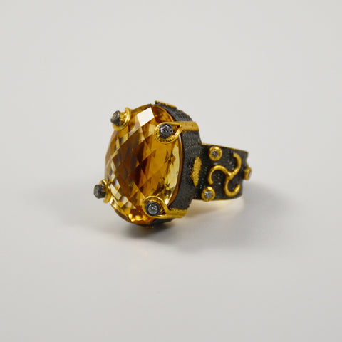 Manjusha Oval Faceted Citrine Set in Rhodium and Gold Band