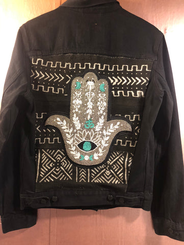 Black Denim jacket with added hand beaded Hamsa on African Mud cloth